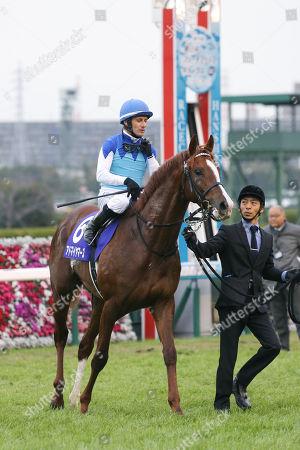 Admire Mars ( Mirco Demuro) - Horse Racing : Admire Mars ridden by Mirco Demuro after winning the Asahi Hai Futurity Stakes at Hanshin Racecourse in Hyogo, Japan.