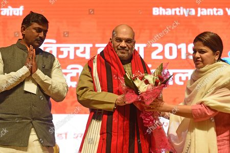 President of Bhartiya Janta Party Yuva Morcha and Member of Parliament Poonam Mahajan felicitates BJP President Amit Shah on the second day of the BJP national workshop, at Civic Centre