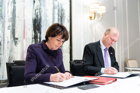 Swiss Federal Councillor Doris Leuthard (L)  signs with British Secretary of State for Transport Chris Grayling (R), an Air Transport Agreement between Switzerland and the United Kingdom, in Zurich, Switzerland, 17 December 2018.