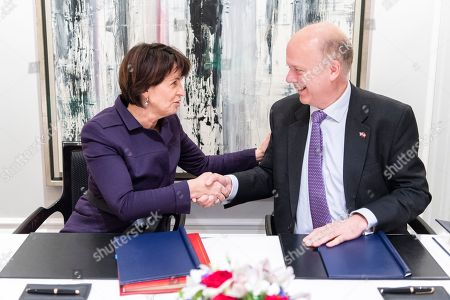 Swiss Federal Councillor Doris Leuthard (L) shakes hand with British Secretary of State for Transport Chris Grayling (R), after signing an Air Transport Agreement between Switzerland and the United Kingdom, in Zurich, Switzerland, 17 December 2018.