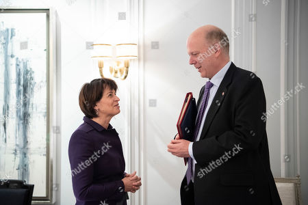 Swiss Federal Councillor Doris Leuthard (L) speaks with British Secretary of State for Transport Chris Grayling (R), after signing an Air Transport Agreement between Switzerland and the United Kingdom, in Zurich, Switzerland, 17 December 2018.