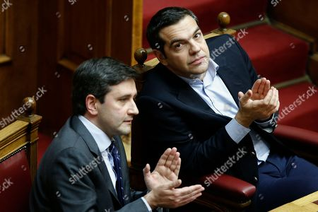 Greek Prime Minister Alexis Tsipras (R) applauds next to Deputy Finance Minister George Chouliarakis (L) during a session in the parliament's plenum prior to a budget vote in Athens, Greece, 17 December 2018. The debate on the Greek government's 2019 draft budget started at the parliament and is scheduled to be concluded after voting on the night of 18 December.