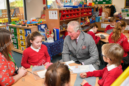 Prince Charles shares a joke with pupils in year four at Leighterton Primary School, Gloucestershire, where he is there to see the new school building and watch pupils take part in a Christmas performance