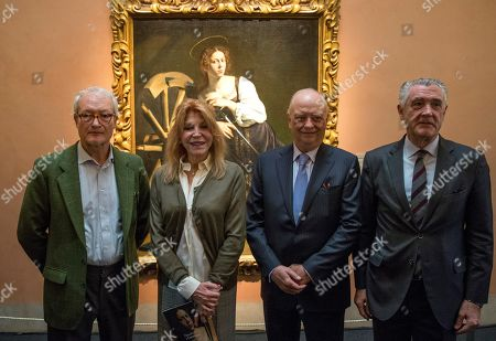 Spanish art collector Carmen Cervera, Baroness Thyssen-Bornemisza (2-L) poses during the presentation of the newly restored oil painting 'Saint Catherine of Alexandria' (1598-99) by Italian Baroque master Caravaggio at the Thyssen-Bornemisza Museum in Madrid, Spain, 17 December 2018.