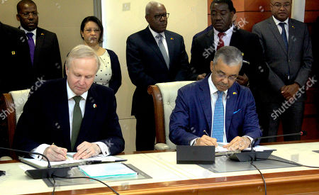 Stock Photo of Carlos Saturnino (R), CEO of Sonangol, and Bob Dudley (L), group Chief Executive of  British Petroleum (BP) sign bilateral agreements between the two oil companies in Luanda, Angola, 17 December 2018.