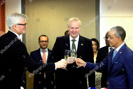 Stock Image of Carlos Saturnino (R), CEO of Sonangol, Bob Dudley (C), group Chief Executive of British Petroleum (BP) and Stephen Willis (L), BP Angola regional president, toast after the signture of bilateral agreements between the two oil companies in Luanda, Angola, 17 December 2018.