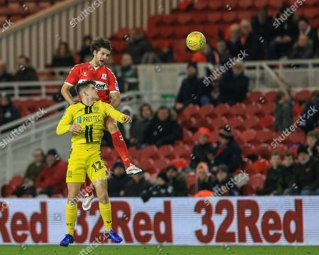 George Friend (03) of Middlesbrough wins the header as Ben Fox (12) of Burton Albion just can't get high enough
