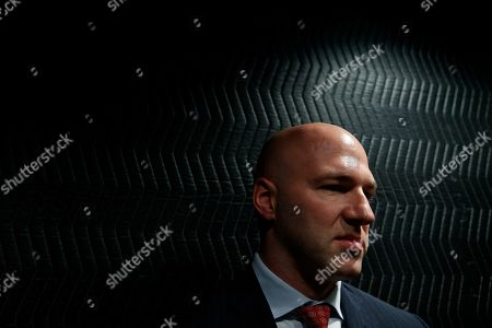 Rep.-elect Anthony Gonzalez, R-Ohio leans against the back on an elevator as he leaves an interview with the Associated Press at the National Republican Congressional Committee offices in Washington