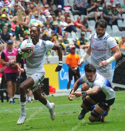 Perry Baker of USA goes past Masaki Kondo of Japan during day 1 of the 2018 HSBC Cape Town Sevens at Cape Town Stadium in Cape Town, South Africa, 08 December 2018.