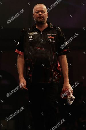 The body language says it all. Raymond van Barneveld looking dejected as he walks off stage after the World Championship Darts 2018 at Alexandra Palace, London