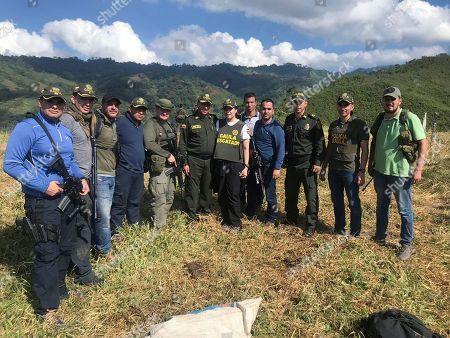 Stock Photo of In this handout photo released by the press office of Colombia's National Police, Melissa Martinez Garcia poses for a photo with the officers that rescued her, in a rural area of Ciengaga, northern Colombia, . Martinez Garcia, grand niece of the late Literature Nobel Price winner Gabriel Garcia Marquez, was kidnapped on Aug. 23, 2018 when she was returning to her home in Santa Marta, from her job on a banana plantation