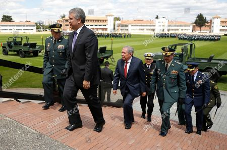 Colombia's President Ivan Duque walks, followed by Defense Minister Guillermo Botero and the new commanders of the military and police, during a swearing-in ceremony for the new military and police commanders, in Bogota, Colombia