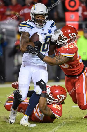 Eric Berry, Virgil Green, Anthony Hitchens. Los Angeles Chargers tight end Virgil Green (88) is tackled by Kansas City Chiefs inside linebacker Anthony Hitchens (53) and Kansas City Chiefs defensive back Eric Berry (29) during an NFL football game in Kansas City, Mo