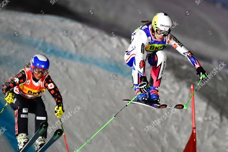 Alizee Baron of France (R) and Mikayla Martin of Canada speed down the track during the women's Ski Cross World Cup event in Arosa, Switzerland, 17 December 2018.