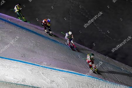 (L-R) Sami Kennedy-Sim of Austria, Mikayla Martin of Canada, Alizee Baron of France, and Andrea Limbacher of Austria speed down the track during the women's Ski Cross World Cup event in Arosa, Switzerland, 17 December 2018.