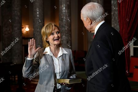 Orrin Hatch, Cindy Hyde-Smith. Sen. Cindy Hyde-Smith, R-Miss., left, stands with Sen. Orrin Hatch, R-Utah, right, during a ceremonial swearing-in on Capitol Hill in Washington