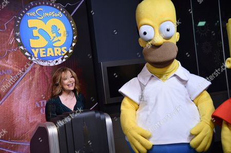 """Stephanie Gillis participates in Fox's """"The Simpsons"""" 30th anniversary celebration at the Empire State Building, in New York"""