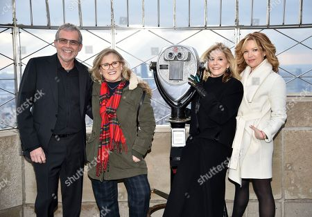 """Mike Scully, Nancy Cartwright, Pamela Hayden, Stephanie Gillis. Producer Mike Scully, left, voice actor Nancy Cartwright, voice actor Pamela Hayden and writer Stephanie Gillis pose on the 86th floor observation deck during Fox's """"The Simpsons"""" 30th anniversary celebration at the Empire State Building, in New York"""