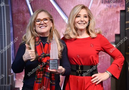 """Nancy Cartwright, Pamela Hayden. Voice actors Nancy Cartwright, left, and Pamela Hayden participate in Fox's """"The Simpsons"""" 30th anniversary celebration at the Empire State Building, in New York"""