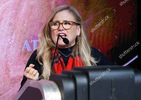 """The voice of Bart Simpson, Nancy Cartwright, participates in Fox's """"The Simpsons"""" 30th anniversary celebration at the Empire State Building, in New York"""