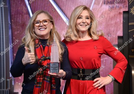 Nancy Cartwright, Pamela Hayden. Nancy Cartwright, who voices the character Bart Simpson, left, and Pamela Hayden, who voices the character Milhouse Van Houten, appear at Fox's 'The Simpsons' 30th anniversary celebration at the Empire State Building, in New York