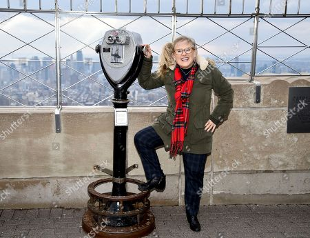 Nancy Cartwright, who voices the character Bart Simpson, participates in Fox's 'The Simpsons' 30th anniversary celebration at the Empire State Building, in New York