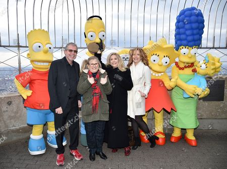 Mike Scully, Nancy Cartwright, Pamela Hayden, Stephanie Gillis. Producer Mike Scully, left, voice actor Nancy Cartwright, voice actor Pamela Hayden and writer Stephanie Gillis pose with 'The Simpsons' costumed characters during Fox's 'The Simpsons' 30th anniversary celebration at the Empire State Building, in New York