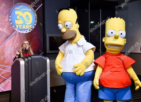 Nancy Cartwright, Homer Simpson, Bart Simpson. The voice of Bart Simpson, Nancy Cartwright, left, participates in Fox's 'The Simpsons' 30th anniversary celebration at the Empire State Building, in New York