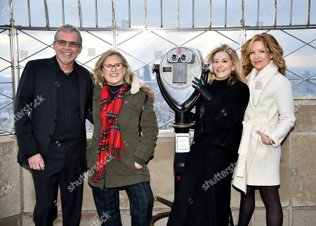 Mike Scully, Nancy Cartwright, Pamela Hayden, Stephanie Gillis. Producer Mike Scully, left, voice actor Nancy Cartwright, voice actor Pamela Hayden and writer Stephanie Gillis pose on the 86th floor observation deck during Fox's 'The Simpsons' 30th anniversary celebration at the Empire State Building, in New York