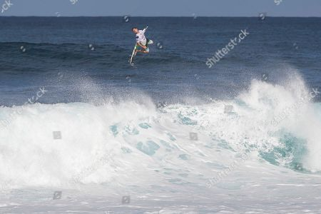 Joel Parkinson exits behind the wave during the action at the Billabong Pipe Masters in memory of Andy Irons at Ehukai Beach Park in Haleiwa, HI