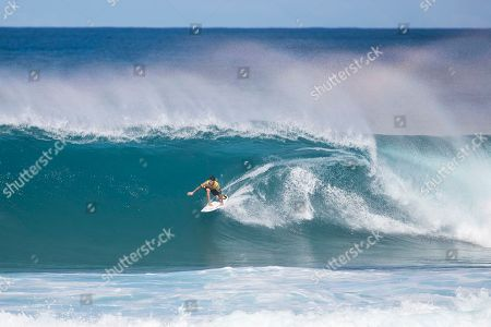 Stock Image of Gabriel Medina gets ready to get covered by a barrel during the Quarterfinals action at the Billabong Pipe Masters in memory of Andy Irons at Ehukai Beach Park in Haleiwa, HI