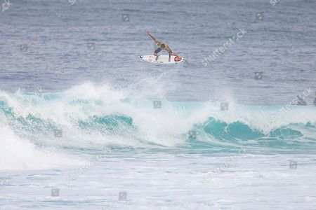 Brazilian surfer Gabriel Medina takes flight during the Round 4 action at the Billabong Pipe Masters in Memory of Andy Irons at Ehukai Beach Park in Haleiwa, HI