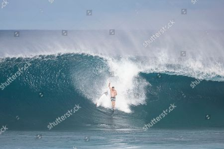 during the action at the Billabong Pipe Masters in memory of Andy Irons at Ehukai Beach Park in Haleiwa, HI