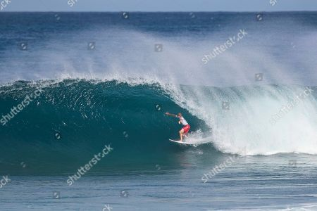 Kelly Slater rides a Backdoor wave during the action of Round 4 at the Billabong Pipe Masters in memory of Andy Irons at Ehukai Beach Park in Haleiwa, HI
