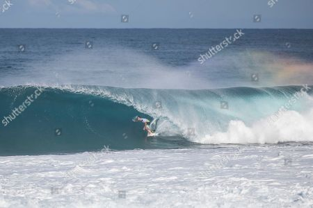 Joel Parkinson goes right on a Backdoor wave during the action of Round 4 at the Billabong Pipe Masters in memory of Andy Irons at Ehukai Beach Park in Haleiwa, HI