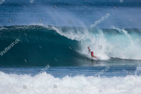 Kelly Slater jumps off his board during the action at the Billabong Pipe Masters in memory of Andy Irons at Ehukai Beach Park in Haleiwa, HI