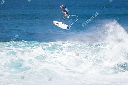 Julian Wilson jumps off his board mid flight during the action at the Billabong Pipe Masters in memory of Andy Irons at Ehukai Beach Park in Haleiwa, HI