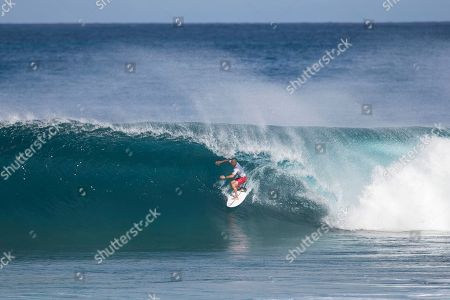 Kelly Slater rides a Backdoor wave during the Round 4 action at the Billabong Pipe Masters in memory of Andy Irons at Ehukai Beach Park in Haleiwa, HI