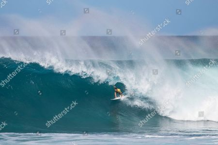 Gabriel Medina rides a Backdoor wave during the Quarterfinals action at the Billabong Pipe Masters in memory of Andy Irons at Ehukai Beach Park in Haleiwa, HI