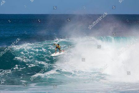 Gabriel Medina comes out of a barrel during the Quarterfinals action at the Billabong Pipe Masters in memory of Andy Irons at Ehukai Beach Park in Haleiwa, HI