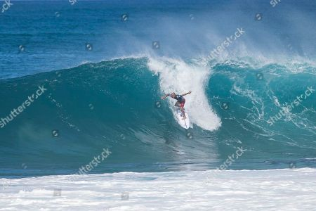Kelly Slater rides a Backdoor during the Quarterfinal action at the Billabong Pipe Masters in memory of Andy Irons at Ehukai Beach Park in Haleiwa, HI