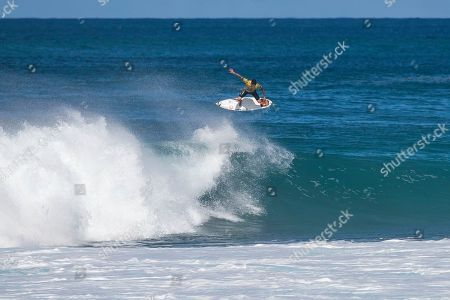 Gabriel Medina comes out of a barrel then gets some air during the Quarterfinals action at the Billabong Pipe Masters in memory of Andy Irons at Ehukai Beach Park in Haleiwa, HI