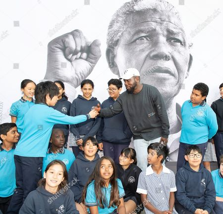 Kweku Mandela (2-R), the grandson of late South African President Nelson Mandela, interacts with school students at the Melbourne Museum in Melbourne, Australia, 18 December 2018. Kweku Mandela visited the 'Mandela: My Life' Exhibition for the first time and guided a group of Year 6 students from Carlton Gardens Primary School through the exhibition.