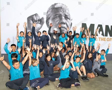 Kweku Mandela (C), the grandson of late South African President Nelson Mandela, poses for a photograph with school students at the Melbourne Museum in Melbourne, Australia, 18 December 2018. Kweku Mandela visited the 'Mandela: My Life' Exhibition for the first time and guided a group of Year 6 students from Carlton Gardens Primary School through the exhibition.