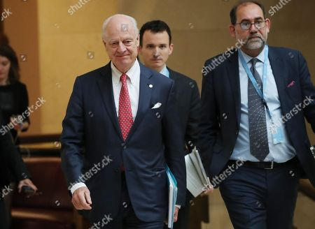 United Nations Special Envoy for Syria Staffan de Mistura (L) attends a meeting on forming a constitutional committee in Syria at the United Nations in Geneva, Switzerland,  18 December 2018. Others are not identified.