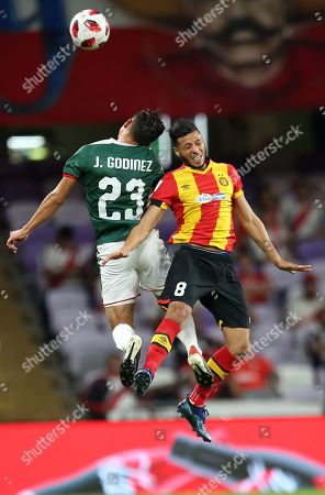 Anice Badri (R) of ES Tunis in action against Jesus Godinez (L) of CD Guadalajara during the FIFA Club World Cup 2018 fifth place soccer match between ES Tunis and CD Guadalajara in Al Ain, United Arab Emirates, 18 December 2018.