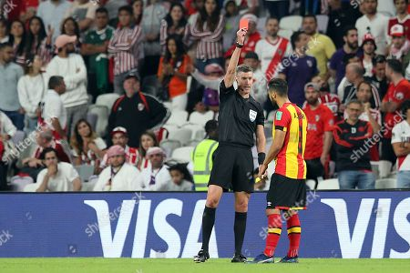 Stock Picture of Anice Badri (R) of ES Tunis is sent off by New Zealand referee Matthew Conger (L) during the FIFA Club World Cup 2018 fifth place soccer match between ES Tunis and CD Guadalajara in Al Ain, United Arab Emirates, 18 December 2018.