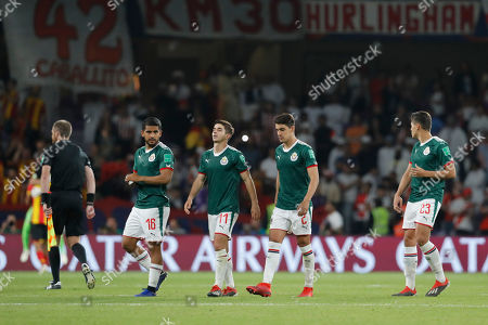 b54d0bf7a9d Mexico s Guadalajara Isaac Brizuela walks with his teammates after losing  the penalty shootout the during Club