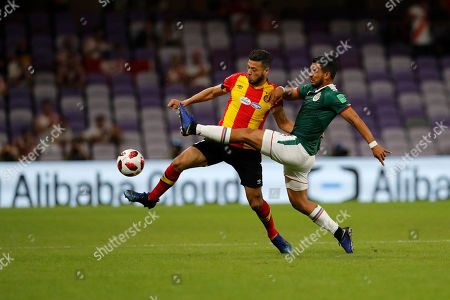 Mexico's Guadalajara Miguel Ponce and Tunisia's ES Tunis Anice Badri fight for the ball during the Club World Cup soccer match for the fifth place between ES Tunis and Guadalajara at the Hazza Bin Zayed stadium in Al Ain, United Arab Emirates