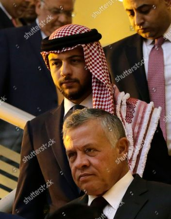 King Abdullah II of Jordan (Front) and Crown Prince of Jordan Al Hussein bin Abdullah (2-Front) arrive to attend the Churches Christmas and New Year celebration event at King Hussein Cultural Center, in Amman, Jordan, 18 December 2018. Jordan's King Abdullah II and his guest Palestinian President Mahmoud Abbas attended the celebration along with leaders of Catholic, Orthodox, and Coptic churches in Jordan and Palestine as well as Muslim dignitaries.